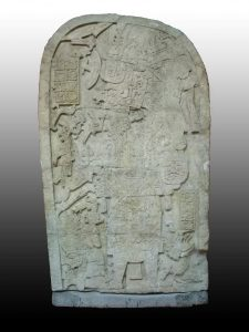 Photo of Machaquilá Stela 2, provided by and used with the permission of MUNAE; the cuts made by looters to render the sculpture into transportable blocks are visible.